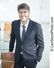 successful businessman standing by the desk. - businessman...