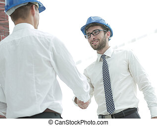 handshake architect and civil engineer - welcoming handshake...