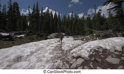 Backpacker entering the Valley near Blue lake Colorado...