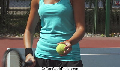 Woman preparing to hit the tennis ball with a racket