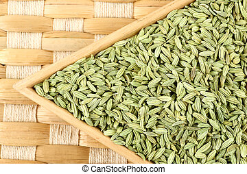 fennel seeds on mat background