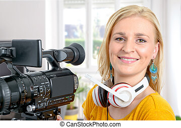 blond young woman with professional video camera,