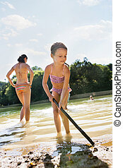 Mother and daughter in the lake. Sunny summer. - Beautiful...