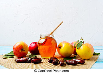 Honey jar, dates and ripe apples on burlap napkin - Honey...