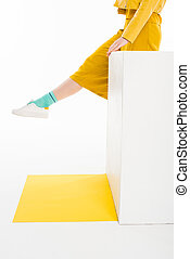 girl dressed in yellow with turqouise socks - cropped shot...