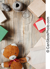 Vintage wooden background with teddy bear, gift boxes and...