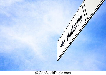 Signboard pointing towards Huntsville - White signboard with...