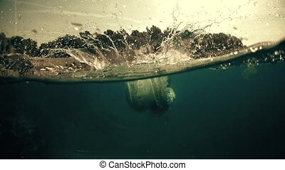 Man diving into the sea, waterline shot - Man diving into...