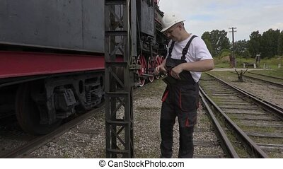 Railway employee take pictures on smart phone near...