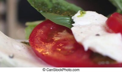 Fresh delicious Italian Caprese salad with basil leaves....