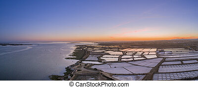 Sunset aerial panoramic view, in Ria Formosa wetlands...