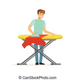 Young smiling man ironing clothes on ironing board, house...