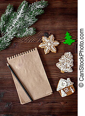 notebook and goals for new year wooden background top view -...