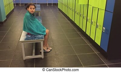 girl teenager in the locker room wipes himself with a towel....