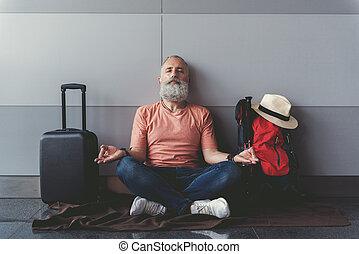 Assured mature bearded man locating near wall - Relaxed...
