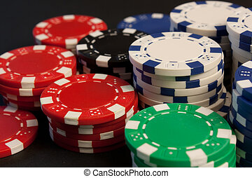 Poker Chips - Colorful poker chips stacked up.