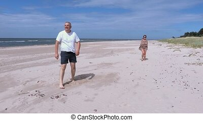 Man with Frisbee disc on the beach