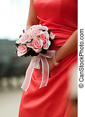 Bridesmaid's bouquet of flowers in wedding