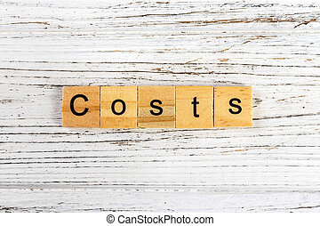 COSTS word made with wooden blocks concept