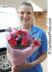 Portrait Of Florist With Van Making Home Delivery Of Bouquet