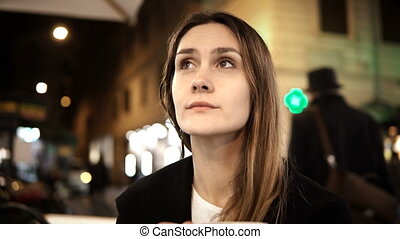 Young beautiful woman sitting in the city centre in cafe,...