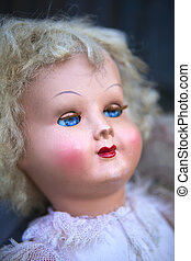 Head of a doll - Close up of an old porcelain doll in a flea...