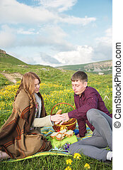 Young married couple on picnic outdoors