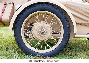 the wheel and tire of a military sidecar - close up of the...