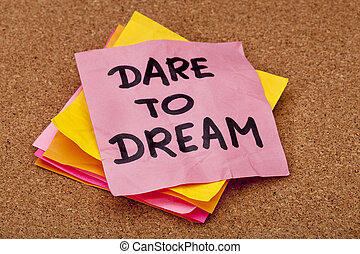 dare to dream, motivational slogan, colorful sticky notes on...