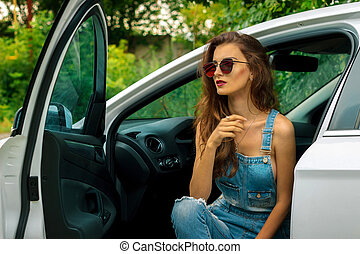 Portrait of beautiful girl in the car