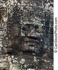 Stone smiling face in Prasat Bayon, part of Angkor - Stone...
