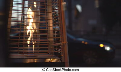 Close-up view of gas outside heater, open fire light near...