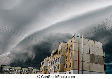 Beautiful storm sky with clouds over the city, apocalypse like