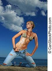 fashion model in jeans by the sea