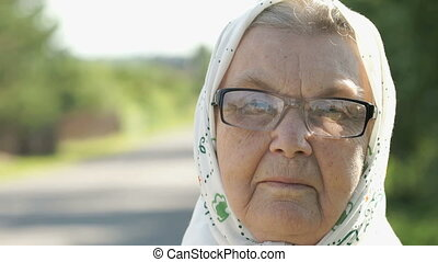 Serious mature elderly woman in glasses. Close-up - Portrait...