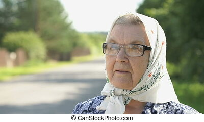 Serious mature old woman in glasses. Close-up