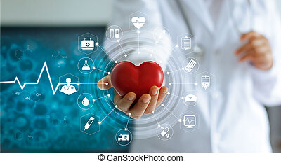 Medicine doctor holding red heart shape in hand and icon...