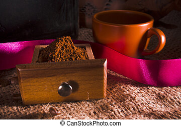 Ground coffee and ceramic cup