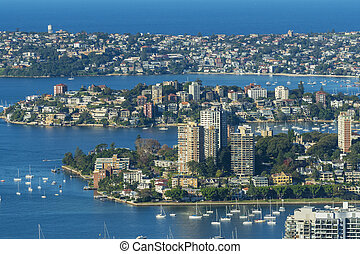 Houses and apartments along the shore of Sydney Harbour -...