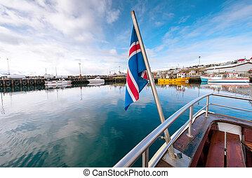 Icelandic flag against the pier