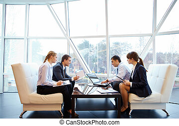 Working in office - Photo of confident partners interacting...