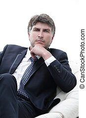 close-up. Confident businessman sitting in a chair -...