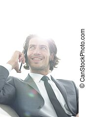 successful business man talking on a smartphone.photo with...