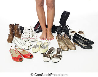 Woman having a hard time choosing what shoes to wear