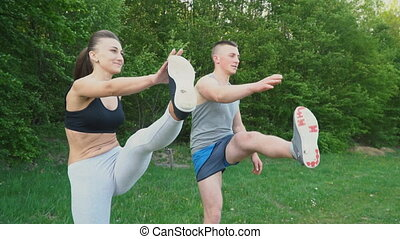 Guy with a girl warm up in nature