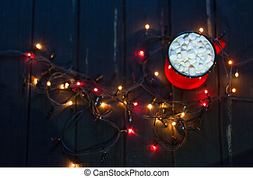 Decorative garland. Christmas lights on dark background and...