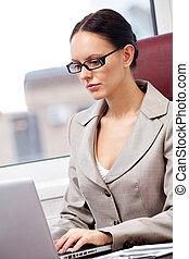 Secretary typing - Portrait of a successful businesswoman...