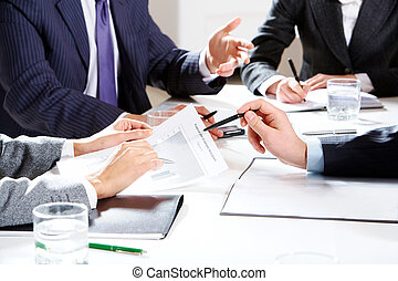 Planning - Close-up of businessman hand with pen explaining...