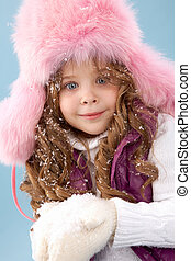 Winter girl - Happy girl in pink furry hat with snow in...