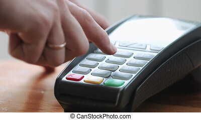 Person using credit card - Close-up shot of person using...